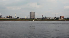 View of industrial buildings over the bay, Ijmuiden, Netherlands Stock Footage