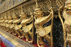 The Golden Pagoda and Yak statue at the phra keaw, bangkok,Thailand - stock photo