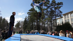 Acrobat on trampoline during the festival Stock Footage