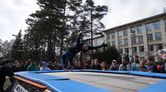 Young gymnast on trampoline during the festival Stock Footage
