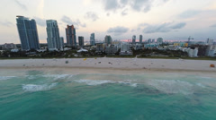 Beautiful South Beach at Dusk, Sunset off in the distance Stock Footage