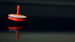 Whirligig on black background. Stock Footage