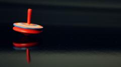 Whirligig on black background. - stock footage