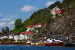 Boats in risor, norway Stock Photos