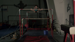 Young Female Gymnast Performing on Bars Stock Footage