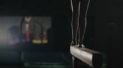 Young Female Gymnast Performing on Beam Stock Footage