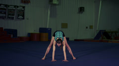 Young Female Gymnast Performing Stock Footage