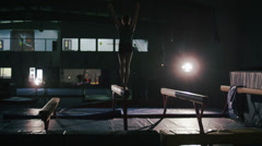 Young Female Gymnast Performing in Gymnasium Stock Footage