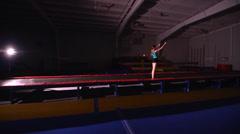 Young Female Gymnast Backflip wide shot Stock Footage