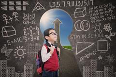 Asian boy standing in class with success road view from keyhole Stock Illustration