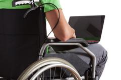 paralyzed teenager with laptop - stock photo