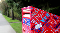 Placing mail in a mail box Stock Footage