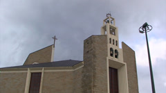 Time lapse on clouds over newish catholic church Stock Footage