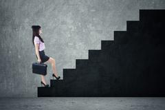 businesswoman stepping up a stairway - stock illustration