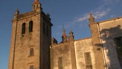 Old stone made cathedral church at sunset - pan left Stock Footage