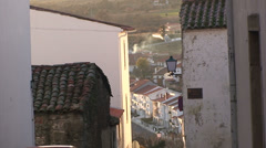 Narrow street in white washed old town at sunset Stock Footage