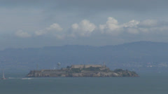 Aerial view San Francisco Alcatraz Island cloud foggy day boat ship tourist USA Stock Footage