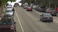Cable car wagon downhill avenue San Francisco Foggy day traffic car street USA  Stock Footage