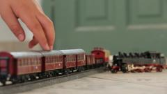 Kid hand moving Toy train Stock Footage