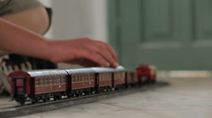 Kid hand moving Toy train backward Stock Footage