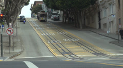 Cable car uphill avenue street road San Francisco passenger commuter travel day  Stock Footage