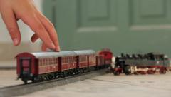 Kid hand moving Toy train back and forth Stock Footage