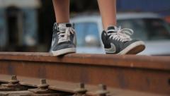 Kid walking on old train tracks Stock Footage