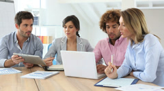 Group of business people meeting around table Stock Footage