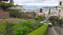 Timelapse Lombard Street car pass downhill switchback San Francisco section city Stock Footage