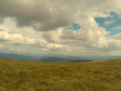mountain landscape view of the clouds and the hills in the distance, dry grass - stock footage
