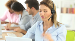 sales representative woman with headset on - stock footage
