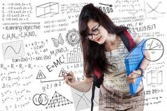 Young student writing on whiteboard Stock Illustration
