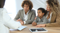 Family meeting real-estate agent for home purchase Stock Footage