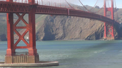 Timelapse Golden Gate Bridge traffic cruise ship boat pacific ocean cliff ferry  Stock Footage