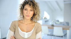 blond woman with curly hair talking to camera - stock footage