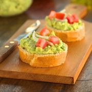 Baguette with avocado Stock Photos