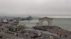 Timelapse old gate aerial view panorama pacific ocean port harbour people USA US Stock Footage