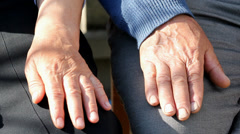 Emotional scene, old woman hand touch, caress, hold old man hand Stock Footage