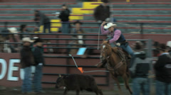 Cowboy ropes steer at rodeo Stock Footage