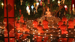 Buddhist monk fire candles to the Buddha. Stock Footage