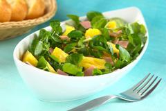 Watercress pineapple ham salad Stock Photos