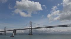 Bay bridge connection ocean pacific water blue sky cloud San Francisco USA ship Stock Footage