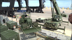 Us Navy unloading vehicles in harbour Stock Footage