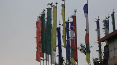 Buddhist prayer flags moving in the wind near the Himalaya mountains. Stock Footage