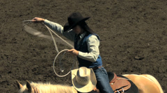 Woman twirling rope at rodeo Stock Footage