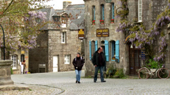Tourists visiting the historic town of Locronan France Stock Footage