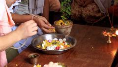People of different races offer flowers to a Giriraja shila Stock Footage