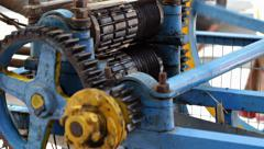 The gears of a blue sugarcane extractor turn. Stock Footage
