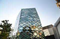 rhomboid-grid glass building in tokyo - stock photo
