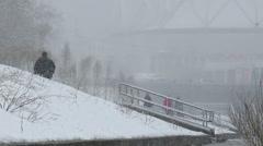 People walking in the snow. Bad weather. Ekaterinburg. Russia Stock Footage